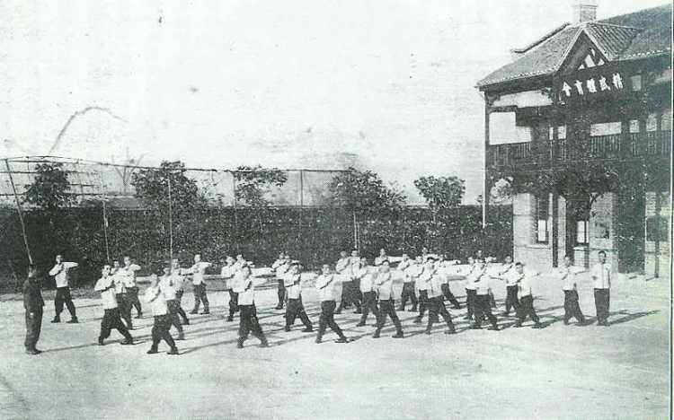 A typical Jingwu training class in front of the second Shanghai Headquarters of the group.  Note the emphasis on forms and line-drills.