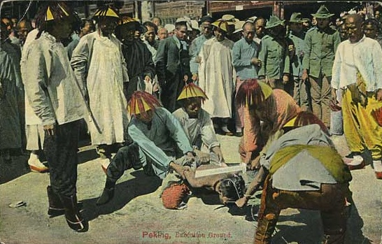 Public execution photographed for a Qing era postcard, hand-tinted.  Postcards such as this one are relatively common and reflect the raciest bias of western consumers in the early 20th century who say the Chinese as implacably violent, subversive and threatening.  Unfortunately that also accurately reflect the swift and brutal nature of justice in late imperial China.  Public executions were often used to deal with market thieves.