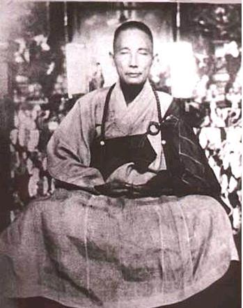 Cheung Lai Chuen, dressed in Buddhist robes.