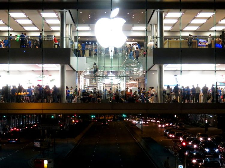 Young adults packed into the Apple Store in the International Finance Center Mall, Hong Kong 2012.