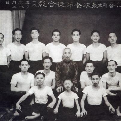 Ip Man and an early group of students in the 1950s. In many ways Ip Man represents the fundemental paradox of the modern martial art's quest for authenticity. He was an undenibaly genuine and talented local martial artist, yet he is current being infused back into Chinese martial culture through the medium of almost entirely fictional films.