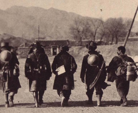 Japanese soldiers carrying a trophy sword in Manchuria, 1932.