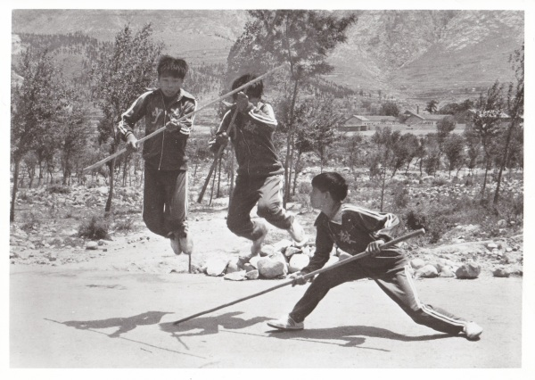 "Three unidentified children practice Kung Fu near the Shaolin Temple.  This photo was taken in 1982 and it captures the first moments of the ""Golden Age"" of Kung Fu in mainland China."