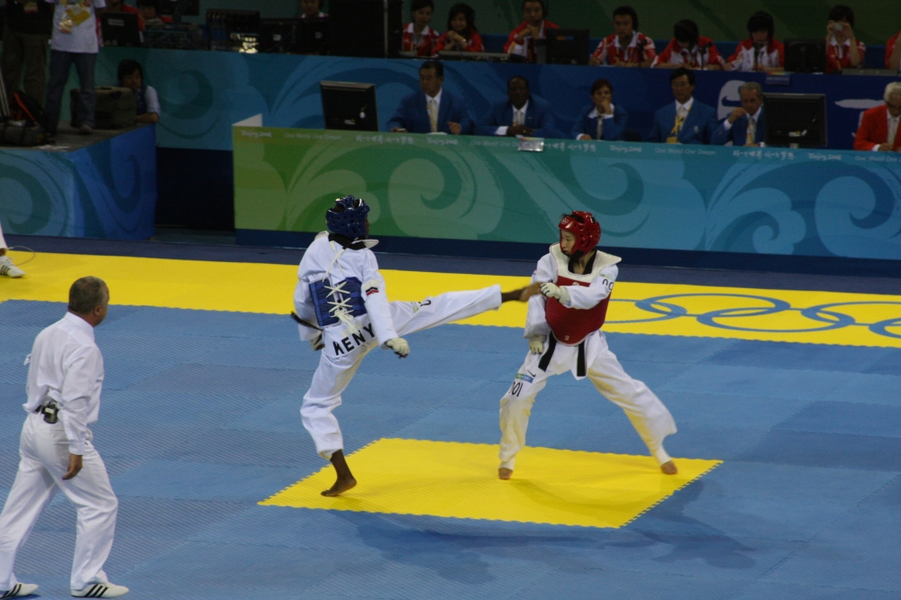 2008 Olympic Tae Kwon Do bout between Mildred Alango and Wu Jingyu.  When will we see Wushu as an Olympic sport? Source: wikimedia.