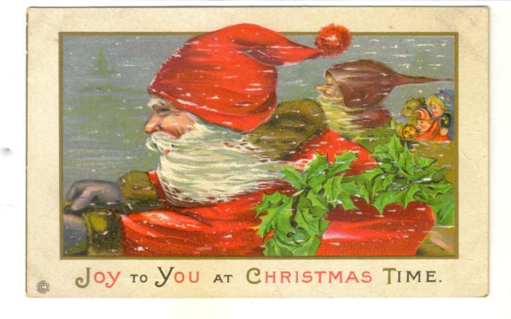 Bernard the Kung Fu Elf riding Shotgun with Santa. (Source: Vintage American Postcard, authors personal collection.)