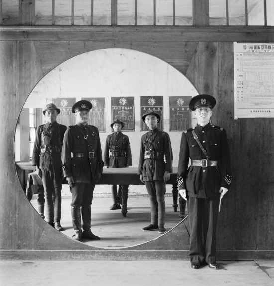 Assistant Chief of Police and his staff at the Headquarters in Chengtu, 1944.  This photograph was taken by the well known war photographer Cecil Beaton.