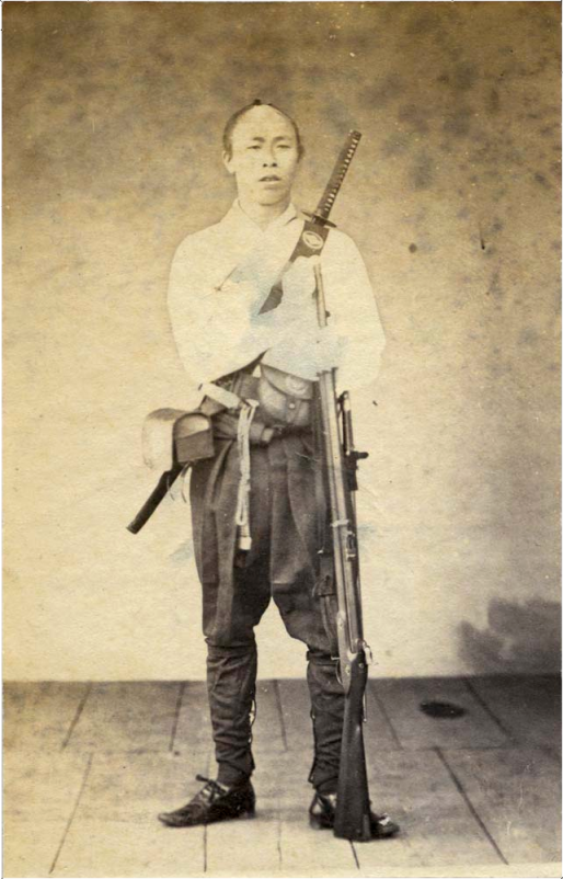 Japanese Samurai by Ueno Hikoma, 1860s.  Note the modern European musket and larger sword bayonet that he carries in addition to a traditional sword worn across the back.  Source: Wikimedia.