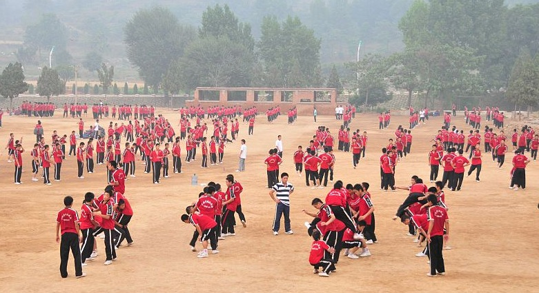 Children train at a Wushu based boarding school in Dengfeng, near the Shaolin Temple.