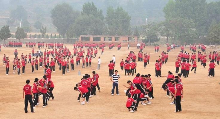 Children train at a Wushu based boarding school in Dengfeng, near the Shaolin Temple.