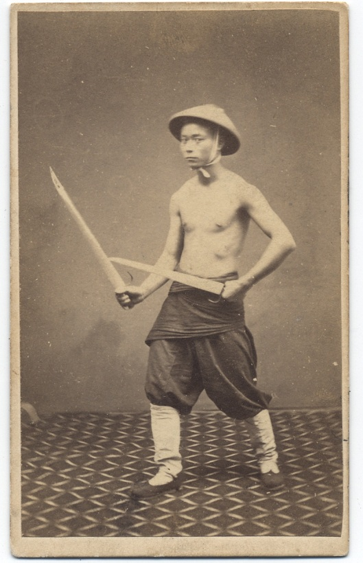 """1860s photograph of a """"Chinese Soldier"""" with butterfly swords. Subject unknown, taken by G. Harrison Grey."""