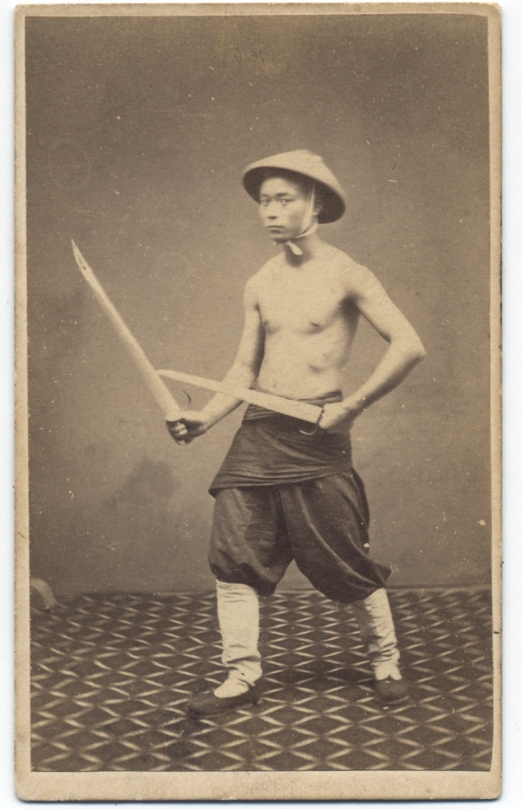 "1860s photograph of a ""Chinese Soldier"" with butterfly swords. Subject unknown, taken by G. Harrison Grey."