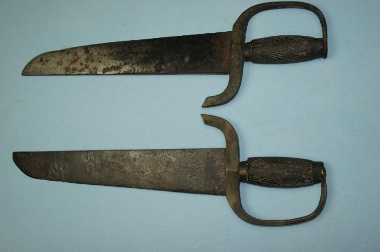 "These hudiedaos have thick brass grips, a wider blade better suited for chopping and a strong hatchet point. Their total length is just over 60 cm. This was the most commonly produced type of ""butterfly sword"" during the middle of the 19th century. Photo courtesy of http://www.swordsantiqueweapons.com."