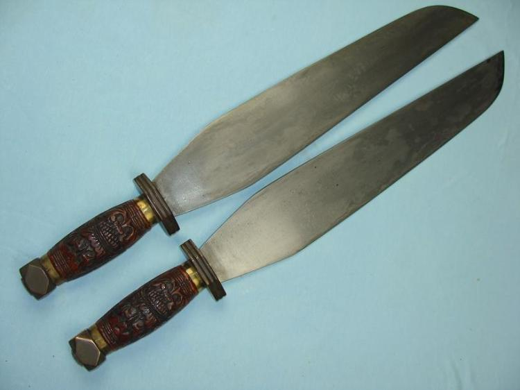 These unusual hudiedao feature handles and blades that are both based on traditional Chinese fighting knives. In this case the blade has been made both longer and wider. Fighting knives do not commonly have hand guards, which are also missing from this example. I have seen a couple of sets of knives in this configuration, though they seem to be quite rare. These knives are 49 cm long and 65 mm wide at the broadest point. Probably early 20th century. Photo courtesy of http://www.swordsantiqueweapons.com.