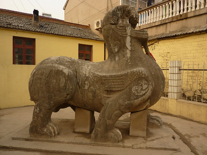 This ancient depiction of a Qilin was a guardian fir the tomb of the Emporer Wu of Li Song (3xx-xxx).  Note that this creature has wings and more closely resembles a central Asian griffin than a later Chinese Qilin.  Source: Wikimedia.