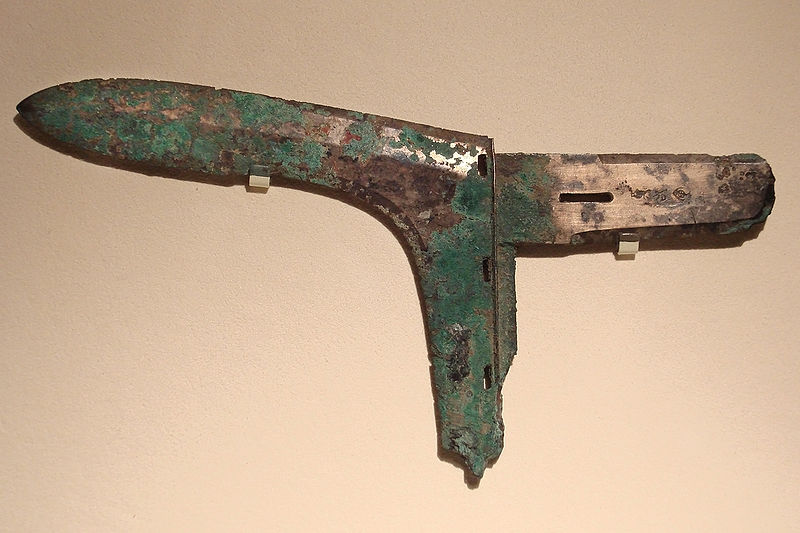 "Zhou period bronze ""ge"" or dagger-ax.  These weapons could be mounted on either long or short poles and were the most common battlefield weapon in Bronze Age china.  Their use may even date back to the neolithic period.  Lore discusses this weapons extensively in the first half of his book.  Source: Wikimedia."