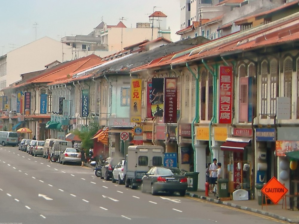 A commercial area of Singapore's Red light District (Geylang Road) by daylight.  This area is is home to numerous traditional martial arts schools and lion dance associations.