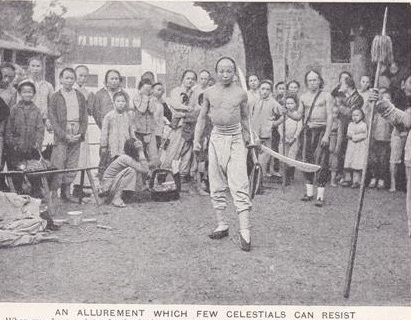 A typical market place demonstration.  Note the two oxtailed Dao's held by the central figure.  these swords are very similar to the ones being sold above.