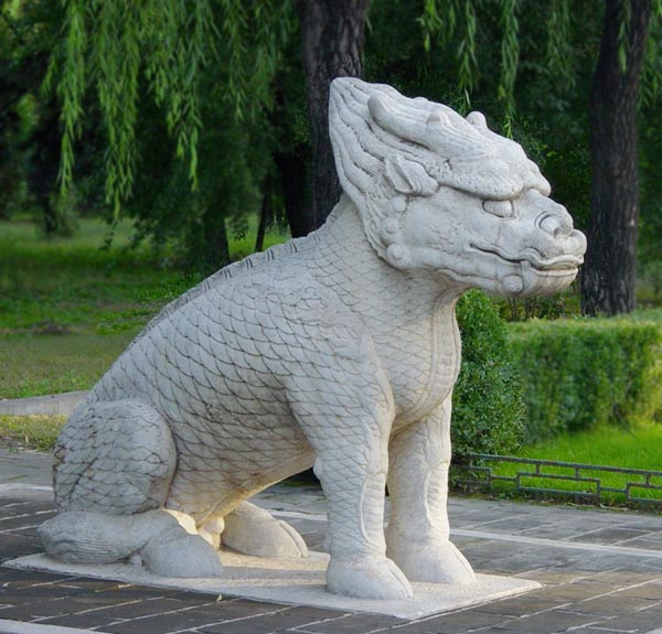 A statue of a Qilin preserved among the Ming Tombs.  this creature shows distinctive dragon and fish characteristics and it clearly hoofed.  Source: wikimedia.