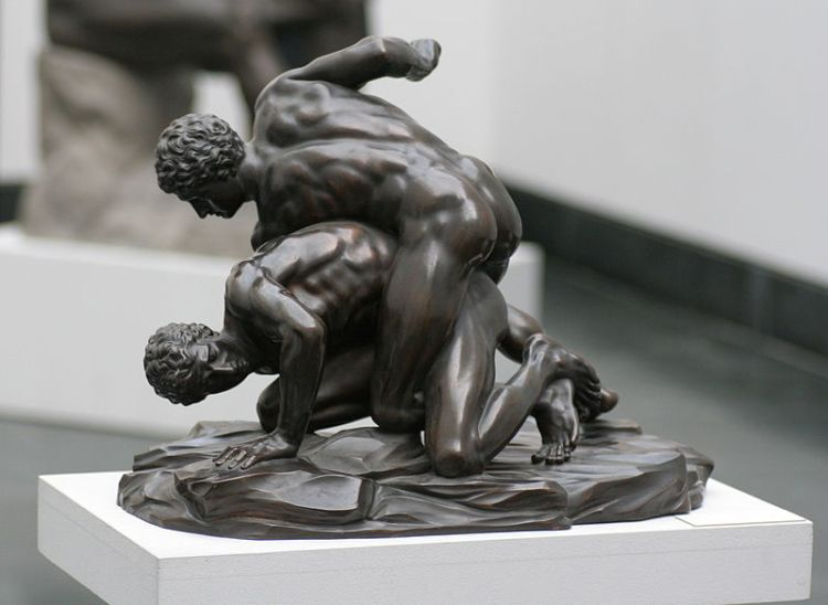 Bronze copy of an ancient Greek statue of two wrestlers, circa 3rd century BC.