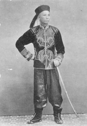 Another Qing military officer armed with a western style saber, circa 1900.