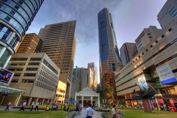 Raffles Place.  An imposing view of the Singapore skyline.  Source: Wikimedia.