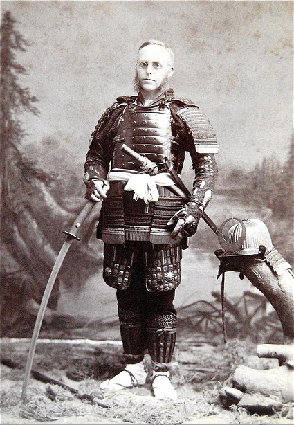 A tourist posing with Japanese weapons, circa 1890.  Photographer unknown.