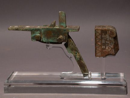 A bronze crossbow lock from the Waring States period.  Source: Wikimedia.