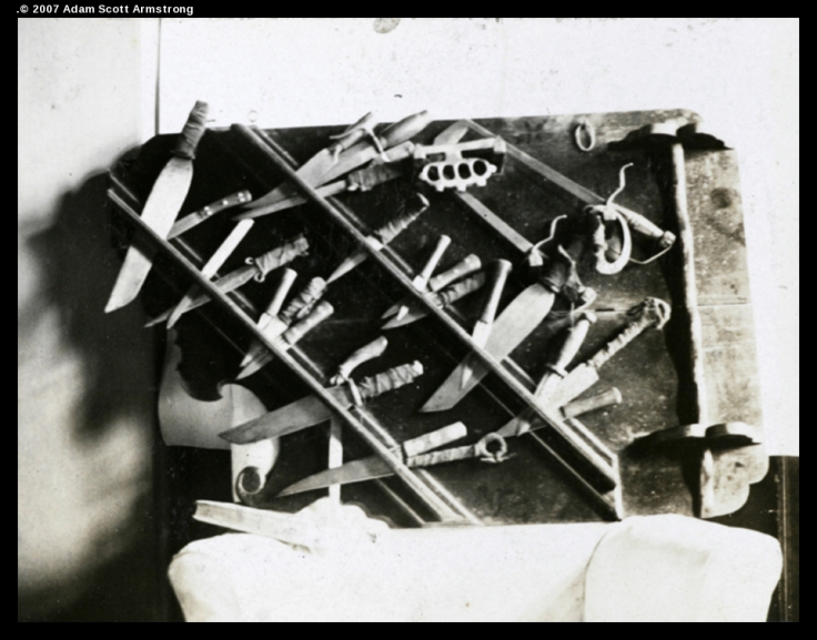 Confiscated weapons. Shanghai Municipal Police Department, 1925. University of Bristol, Historical Photographs of China.