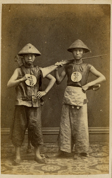 A studio image of two Chinese soldiers (local braves) produced probably in Hong Kong during the 1850s. Note the hudiedao (butterfly swords) carried by both individuals. Unknown Photographer.