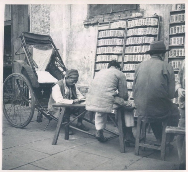 Patrons of a market stall selling sequentially illustrated martial arts novels in 1948.  Source: Vintage AP Press Photo