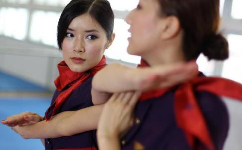 Hong Kong Airline flight crews practice Wing Chun.  Source: South China Morning Post.
