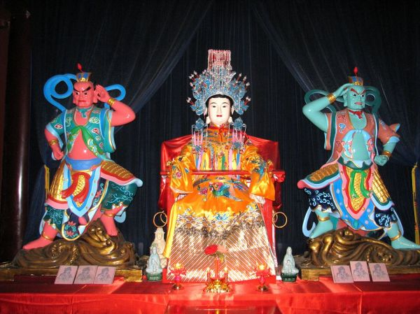 Temple altar dedicated to Mazu and her two helper-deities.