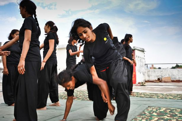 Women practicing martial arts in India.  Source: Mirror.