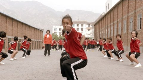 Female student studying Wushu in a scene from Inigo Westmeier's Dragon Girls.