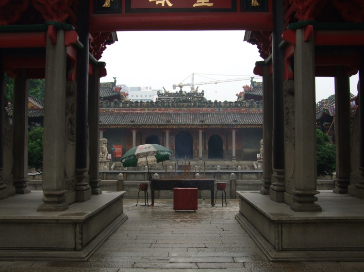 """A rainy day at the Ancestral Temple in Foshan. In the distance the old neighborhood behind the temple is being demolished to make way for a new urban development project. Ironically the new neighborhood is being designed to """"look traditional"""" and capitalize on the area's important """"history."""" Source: Whitney Clayton."""