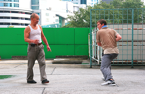 "Nick Hurst training with Queck Chong Tze, his ""Sugong"" or ""Grandmaster"" in the Hokkien dialect."