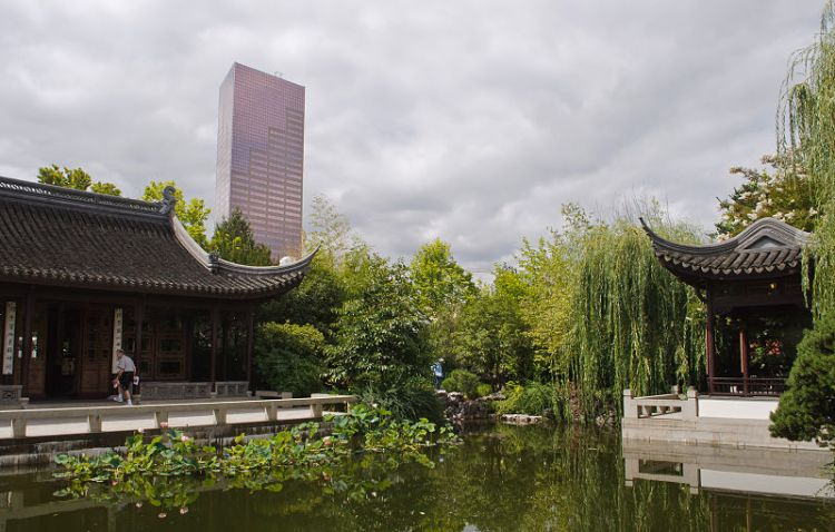 A traditional garden with a modern created within a modern city. Source: Wikimedia.
