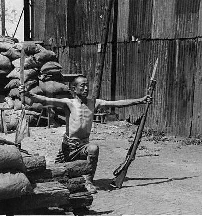 A Chinese soldier performs a sword routine during a later battle for Shanghai, this time in 1937.