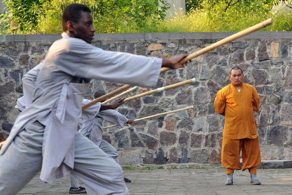A group of African disciples study the traditional arts at Shaolin.