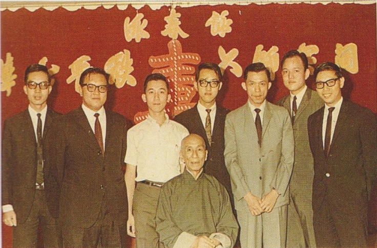 Ho Leun standing to the left of Ip Man. Source: Ip Ching and Ron Heimberger. Mook Yan Jong Sum Fat. 2004.