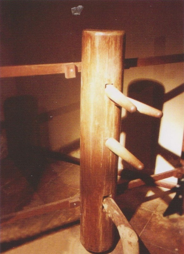 Fung Sheks first dummy, owned by Ip Man, now on display at the Ip Man Tong in Foshan.  Source: Ip Ching and Ron Heimberger. Mook Yan Jong Sum Fat. 2004.