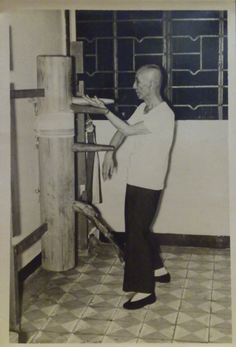 Ip Man demonstrating the wooden dummy form. Photograph was taken in 1967 by Tang Sang and is currently the property of Ip Ching.