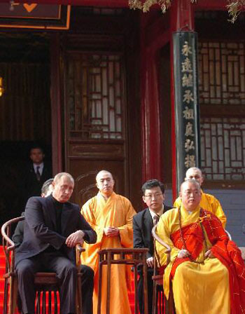 Putin watches a Kung Fu exhibition with the Abbot at the Shaolin Temple in Henan.  Shaolin has become an important stop for visiting VIPs.  Source: People's Daily.