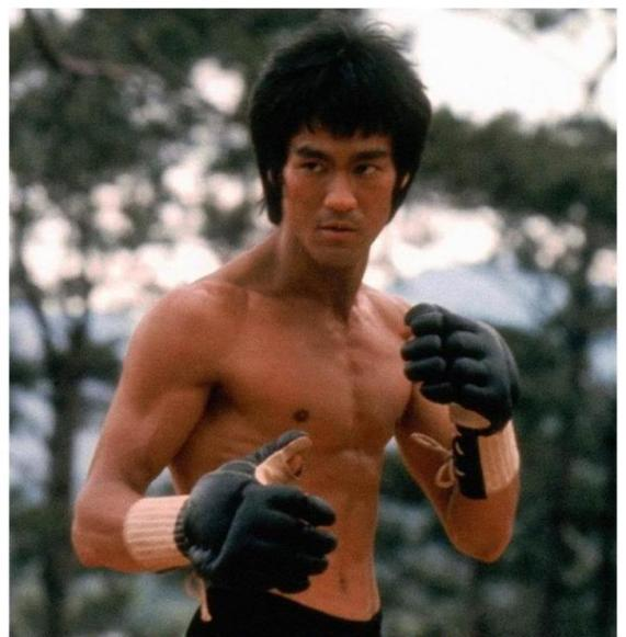 "Still shot of Bruce Lee in the opening scene of ""Enter the Dragon."""
