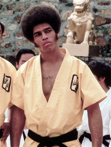 "Jim Kelly on the set of ""Enter the Dragon."""