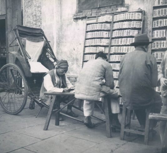 Working class patrons of a stall selling sequentially illustrated martial arts novels. This 1948 AP photo illustrates the importance of heroic martial arts tales in southern China, even for individuals with limited literacy.