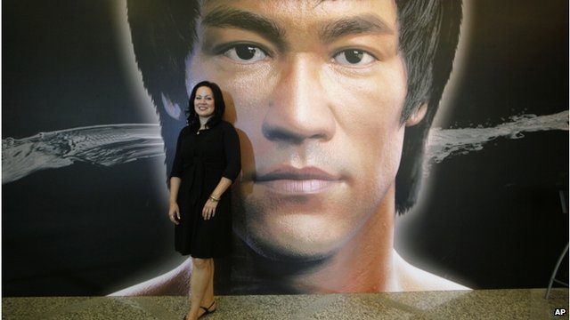 Shannon Lee poses for the press at the opening of an exhibit documenting her father's life and work in Hong Kong.  Source: Associated Press.