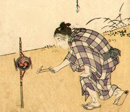 Detail of a figure lighting fireworks.  Artist: Utamaro.