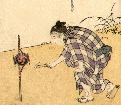 Detail of a figure lighting fireworks.  Artist: Utamaro.