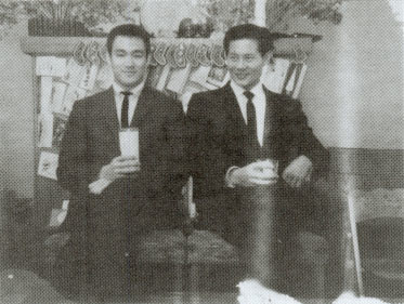 Bruce Lee and James Lee at a Christmas Party